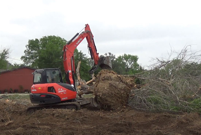 An excavator clearing land in Loudoun County